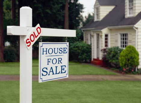 buying-a-green-home-for-sale-sold-sign.jpg